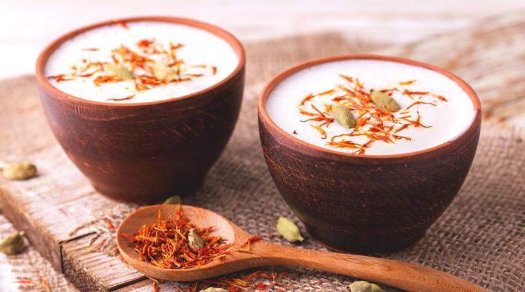 Traditional Indian almond lassi curd with cardamon and saffron served in terracotta glasses. Kesariya. Keshariya. Kesar. Yogurt smoothie